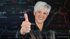 business middle aged woman shows thumb on agreement - financial market(exchange) - stock footage