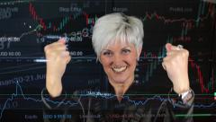 Business middle aged woman rejoices (joy) - financial market (exchange) - graph Stock Footage