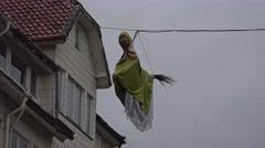 4k Walpurgis witch hanging outdoor near house at cable Stock Footage