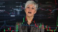 business middle aged woman talks to camera (interview) - financial market - stock footage