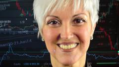 Business middle aged woman smiles (closeup) - financial market (exchange) -graph Stock Footage