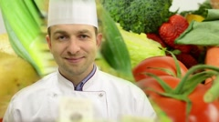 Stock Video Footage of chef smiles to camera - food - vegetables, fruits and bakery products