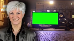 Business middle aged woman smiles - advertising car - green screen -night street Stock Footage