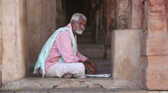Portrait of indian man sitting at the entrance in one of the temples in Hampi. Stock Footage