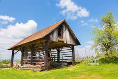 Hayrack and barn in Alpine enviroment, Slovenia - stock photo