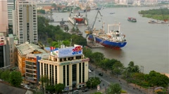Ho Chi Minh City - April 2015: Aerial view of city with traffic and Saigon river Stock Footage