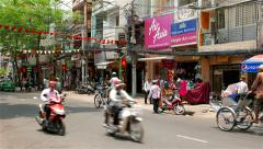 Ho Chi Minh City - April 2015: Street view with people and traffic. 4K Stock Footage