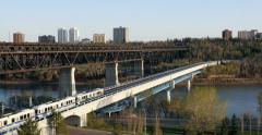 LRT Crosses North Saskatchewan River on a clear, bright afternoon. Version #2 Stock Footage