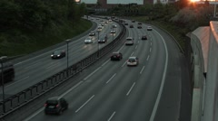 Busy highway with a touch of sunset in the upper right corner Stock Footage