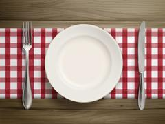 top view of empty plate with spoon and knife - stock illustration