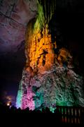 Colorfully lit stone formations in cave at guilin - stock photo