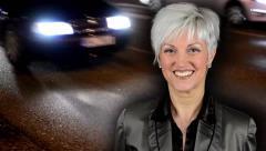 Woman smiles - night urban street-cars and people cross street-timelapse Stock Footage