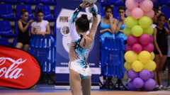 Young gymnast with ball on rhythmic gymnastics tournament Stock Footage