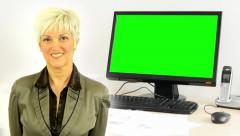 business middle aged woman smiles - desktop computer in the office  green screen - stock footage