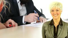 Business middle aged woman smiles - man and woman sign a contract in office Stock Footage