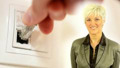 Business middle aged woman smiles - connect network internet cable into socket Stock Footage