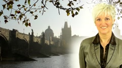 Business middle aged woman smiles - Charles bridge with tree (branch) - sunrise Stock Footage