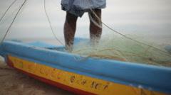Fisherman organizing fishing net in India 1 - stock footage