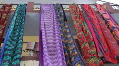 Beautiful, colorful saris drying on the street and swaying in the wind, India - stock footage