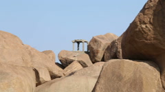 Large stones in Hampi which have been used to make statues of Hindu deities. Stock Footage