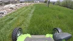 Mowing the lawn with an electric mower Stock Footage