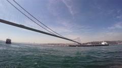 Cargo ship sails under the Bosphorus Bridge Stock Footage