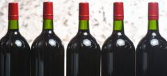 Wine bottles preparation - stock photo
