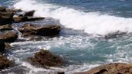 Stock Video Footage of Wave breaking on rocky coast