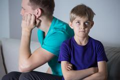 Immature father and bored child Stock Photos