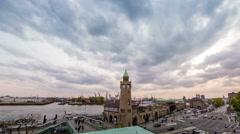 Landungsbrucken with cloudy sky and harbor in the evening Stock Footage