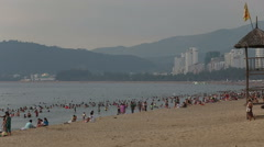 People swim burn on city beach in VietNam at dawn Stock Footage