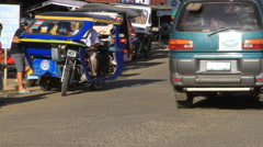 Trikes drive through the Philippines Stock Footage