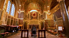 Interior Westminster cathedral. Woman praying Stock Footage