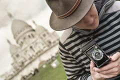 France, Paris, young man taking photograph, Sacre Coeur in background - stock photo