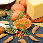 Protein food, eggs, almonds, lentils, cheese, walnut, and curd - stock photo