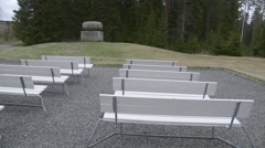 WW2 monument at Trandum Norway white seats slider movement Stock Footage