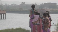 Indian family next to a lake Stock Footage