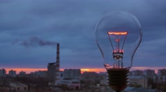 6 in 1 video! The incandescence bulb by the industrial city background. time lap - stock footage