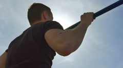 4 in 1 video! The athlete pull on the horizontal bar with bright sun with flare  Stock Footage
