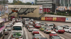 Seven lanes squeezed into two at the tunnel entrance, traffic jam Stock Footage