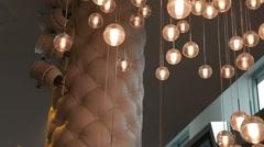 Lights of modern chandelier. Lighting decor. Chandelier close up. Steadicam shot - stock footage