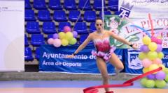 Gymnast with ribbons on rhythmic gymnastics tournament Stock Footage