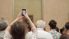 Taking photo of the mona lisa Stock Footage