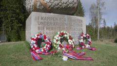 WW2 monument at Trandum Norway wreath of flowers slider movement Stock Footage