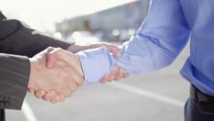 Men exchange keys and shake hands - stock footage