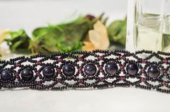 Fragment of a wattled necklace from beads and glass beads - stock photo
