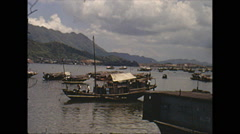 Vintage 16mm film, Hong Kong Chinese junk (boat) in harbor 1973 - stock footage