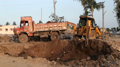 Digger in indian village well known for its temple Virupaksha. Stock Footage