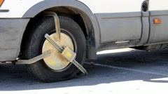 Police anti-theft device on the wheel of the car 2 Stock Footage