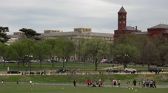 Washington DC local people play sports in Mall park grass 4K 054 Stock Footage
